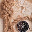 Knot and compass on old paper background — Stock Photo
