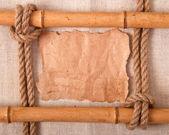 Vecchia carta sullo sfondo di un vecchio panno e nodo — Foto Stock