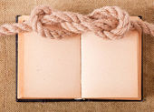 Knot sea and old book — Stock Photo