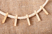 Clothespins on rope — Stock Photo