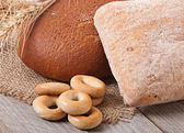 Fresh bread and wheat ears — Stock Photo
