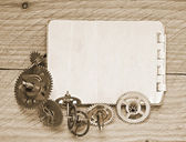 Notebook and gears of the clock — Stock Photo