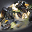 Mussels in a cooking pot - Stock Photo