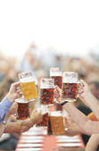 Oktoberfest beer drinkers raise glass — Stock Photo
