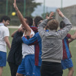 Stock Photo: Soccer team celebrates salvation