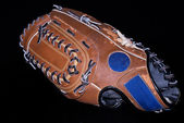 Baseball glove on black — Stock Photo
