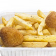 Close up of basket of fries and arancini - Stock Photo