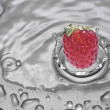 Strawberry falling into water — Stock Photo