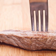 Beef with fork — Stockfoto