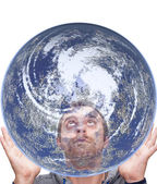 Man holds the earth and look up — Stock Photo
