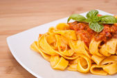 Pasta decorated with basil leaves — Stock Photo