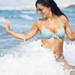 Beautiful girl in wave surf — Stock Photo