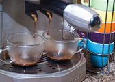 Espresso being drawn out of espresso machine — Stock Photo