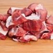 Stock Photo: Raw beef on wooden board