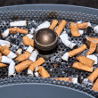 Stock Photo: Many dirty cigarettes butts