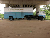 Blue movie truck under the bridge Malaysia — Stock Photo