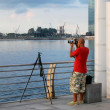 Stock Photo: Photographer at waterfront in Singapore
