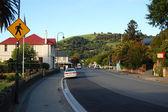 Yellow road sign in Akaroa street — Stock Photo