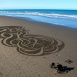 Stock Photo: Sand art on Christchurch beach