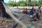 Fishermen cleaning net in Papua New Guinea village — Stock Photo