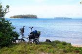 Folding bicycle at Pacific sea coast — Stock Photo