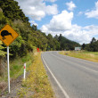Yellow kiwi bird road sign at roadside — Stock Photo