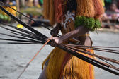 Man with bow and arrow traditional tribal weapon — Stock Photo
