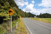 Yellow kiwi bird road sign at roadside — Stock Photo