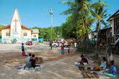 Village market near christian church building — Stock Photo