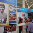 Visitors at ice hockey history exhibition stand — Stock Photo #41681523