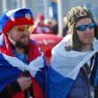 Russispectators with flags at XXII Winter Olympic Games Sochi — Stock Photo #41681603