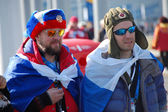Russian spectators with flags at XXII Winter Olympic Games Sochi — Stock Photo