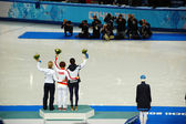 Short-trek speed skating ladies 1500 meters flower ceremony at X — Stock Photo