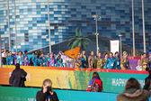 People with balalaika Olympic park at XXII Winter Olympic Games  — Stock Photo