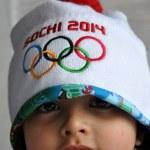 Girl with hat XXII Winter Olympic Games Sochi 2014 logo — Stock Photo #44061213