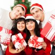Two happy family couples with gift boxes — Stock Photo