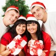 Two happy family couples with gift boxes — Stock Photo #16644289