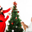 Man and woman decorating Christmas tree — Stock Photo