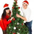 Stock Photo: Man and woman decorating Christmas tree