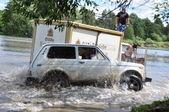 Russian championship trophy raid among SUVs, ATVs and motorcycles. — Stock Photo