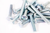 Metal bolts on white background — Stock Photo