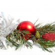 Christmas pine branch with decorations — Stock Photo
