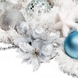 Christmas composition with blue ball and silver flower — Stock Photo