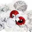 Christmas red and silver decorations on white — Стоковая фотография