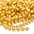 Golden beads Christmas garland — Stock Photo