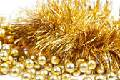 Golden tinsel and beads — Stock Photo