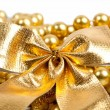Golden Christmas bow and beads — Stock Photo