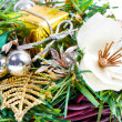 New Year composition with flower, leaves and beads in basket — Stock Photo
