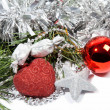 Red Christmas balls and silver star on pine branch — Stock Photo