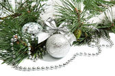 Christmas firtree branch with silver balls, beads and ribbon — Stock Photo